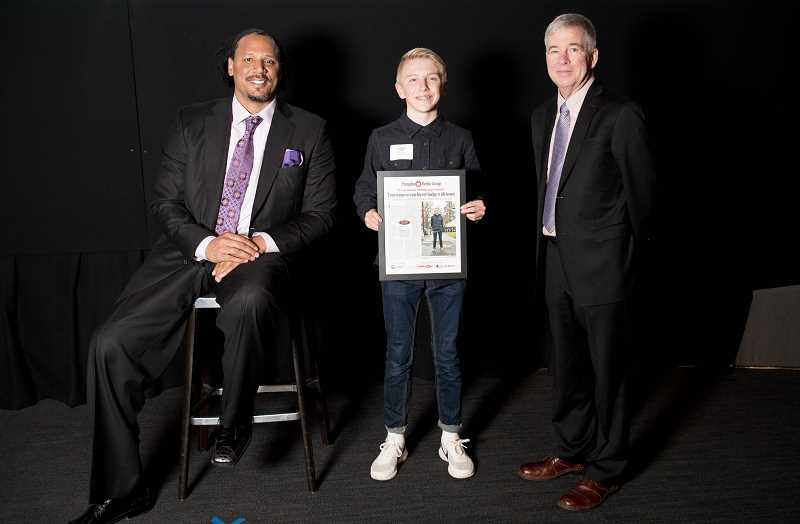 PAMPLIN MEDIA GROUP - Justyn Price, center, Pamplin Media Group's Amazing Kid for 2017, poses with former Trail Blazer Brian Grant, left, and Mark Garber, president of Pamplin Media Group, during an awards presentation held at OMSI on May 11.