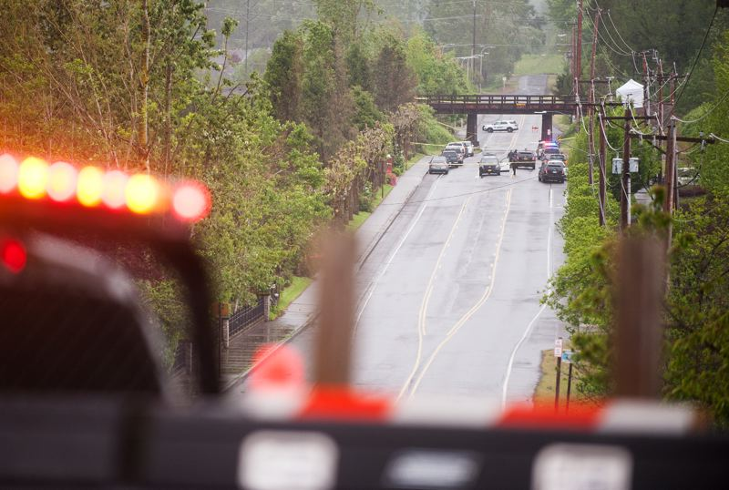 OUTLOOK PHOTO: JOSH KULLA - Northeast 223rd Avenue was blocked this morning at Sandy Boulevard as the Multnomah County Major County Crimes Team investigated a body found farther north where the former  intersects with railroad tracks.