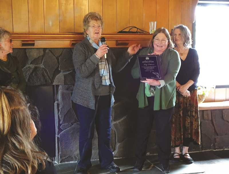 MRW - MRW members Becky Wolfe, left, and Jan Rose, right,  present a recognition plaque to Kay Patteson at a recent MRW event.