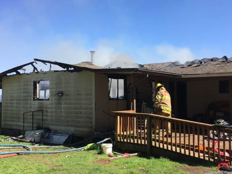 PHOTO COURTESY OF COLUMBIA RIVER FIRE AND RESCUE - Columbia River Fire and Rescue crews respond to a house fire on Clark Road west of Deer Island on Sunday, May 7. The cause of the fire, which killed two dogs and several chicks, is still under investigation.
