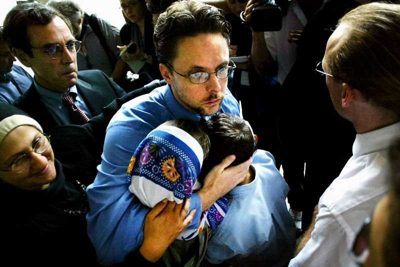 PAMPLIN MEDIA GROUP FILE PHOTO - Brandon Mayfield hugs his two children, Sharia and Famir, in 2004 after he was released from federal detention. The Aloha lawyer was arrested by the FBI as a material witness to the Madrid train bombings. Spanish officials said fingerprints found on a bag containing detonators near the bombing site were  that of an Algerian national, not Mayfields.
