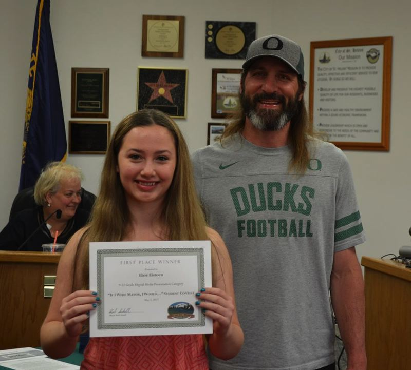 Elsie Elstoen with Mayor Rick Scholl. Elstoen was the contest winner for the high school digital media category.