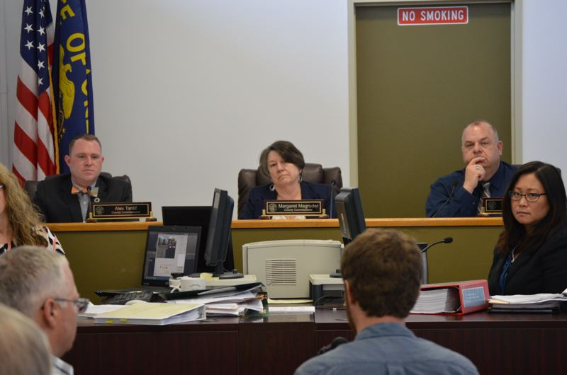 SPOTLIGHT PHOTO: COURTNEY VAUGHN - Columbia County Commissioners Alex Tardif, Margaret Margruder and Henry Heimuller mull the latest draft of the county's Transportation System Plan during a meeting Wednesday, May 3.