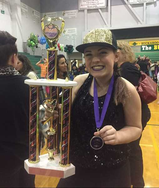 PIONEER PHOTO: CONNER WILLIAMS  - Grace poses for a photo after winning first place in drill down at a dance competition in Pendleton for Dolce Dance in Molalla.