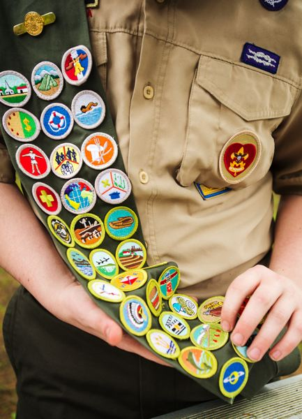 OUTLOOK PHOTO: JOSH KULLA - Boy Scout Matthew Merritt shows of the sash hosting nearly all of his 36 scouting merit badges.