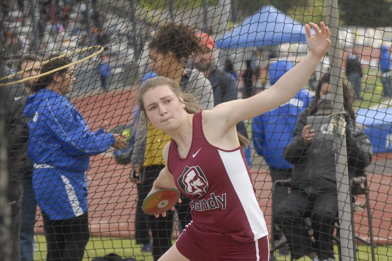 SANDY POST: MATT RAWLINGS - Sandy's Keeley Rasmussen wins the discus at the NWOC district meet