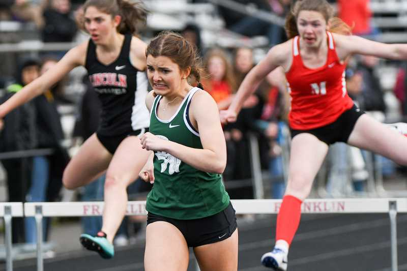 TRIBUNE PHOTO: JOSH KULLA - Wilson High senior Emma Swanson won the girls 300-meter hurdles Friday at the PIL district track and field championships.