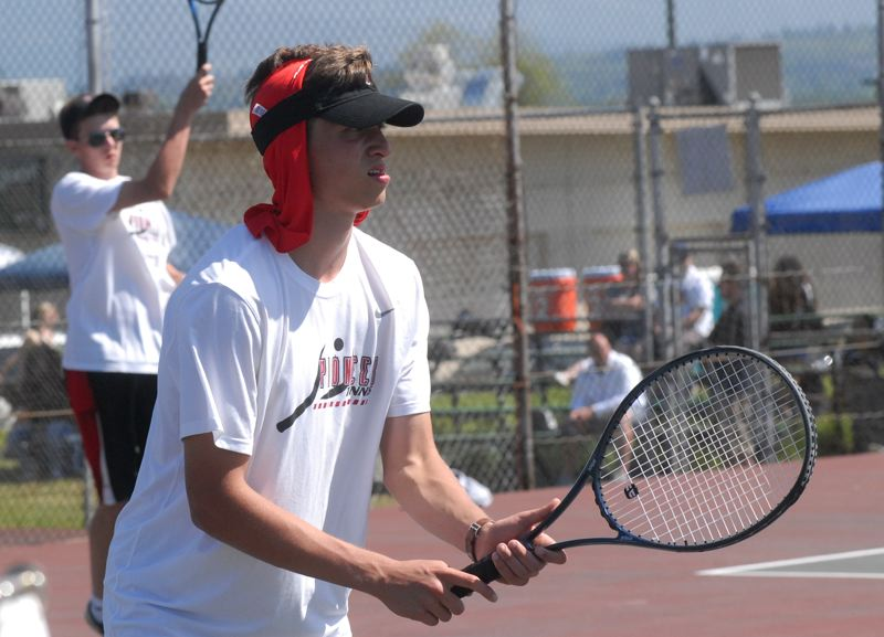 SANDY POST: MATT RAWLINGS - Sandys doubles duo of Grayson Kansala, near, and Ryan McAra, in the background, won the district finals 6-4, 6-4 helping the Pioneers past La Salle Prep in the team trophy hunt, too.