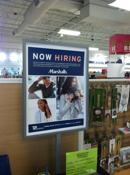 OUTLOOK PHOTO: JOSH KULLA - 'Now Hiring' signs are popping up throughout the metro area, including at the Gresham Marshall's apparel store, as local employers struggle to attract qualified employees in the face of record unemployment rates.