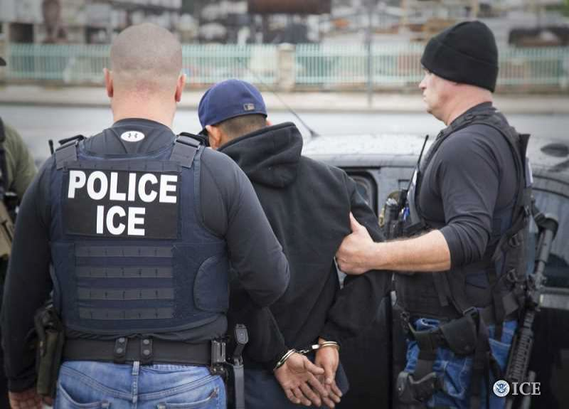 COURTESY PHOTO: ICE - ICE agents arrest an undocumented immigrant.