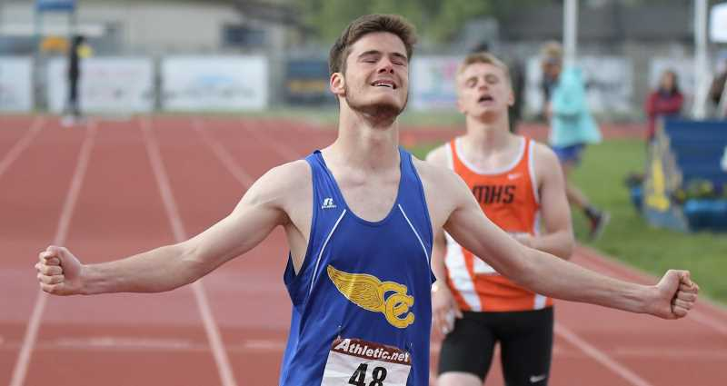 LON AUSTIN/CENTRAL OREGONIAN - Adrien Fournier celebrates after winning the 200-meter dash at the Tri-Valley Conference championships, which were held Friday and Saturday in Prineville. Fournier, a foreign exchange student from France, is also going to state in the 100, 4x100 relay and 4x400 relay.