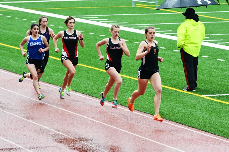 SPOTLIGHT PHOTO: JAKE MCNEAL - Indians junior Linnaea Kavulich won the Cowapa League girls' 1,500- and 3,000-meter runs and came up second in the 1,600 relay with Tess Conway, Emma Jones and Alyssa Spang for Class 4A state seeds on Thursday and Friday, May 11-12, at Doc Ackerson Stadium in St. Helens.