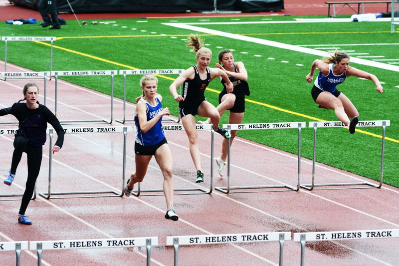 SPOTLIGHT PHOTO: JAKE MCNEAL - Indians freshman Emma Jones won the Cowapa League girls' 300-meter hurdles championship in a personal-best 46.52, followed Astoria junior Darian Hageman (17 feet, 2 inches) in 16-1 in the long jump and helped Linnaea Kavulich, Tess Conway and Alyssa Spang to second in the 1,600 relay (4:09.13) behind Valley Catholic (4:09.03).