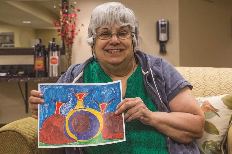 """INDEPENDENT PHOTO: JULIA COMNES - Raquel Sanchez's painting, """"Garden Snails,"""" was recently sold at an Alzheimer's Association art auction. The Silver Creek resident says learning to paint has helped her with some of her epilepsy and dementia symptoms."""