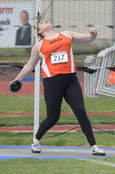 PAMPLIN MEDIA GROUP PHOTO: LON AUSTIN  - Molalla senior Rachel Bring takes first in the Discus at the Tri-Valley district meet on Saturday. Bring also took first in the Shot Put and will look to defend her state titles in both events this weekend.
