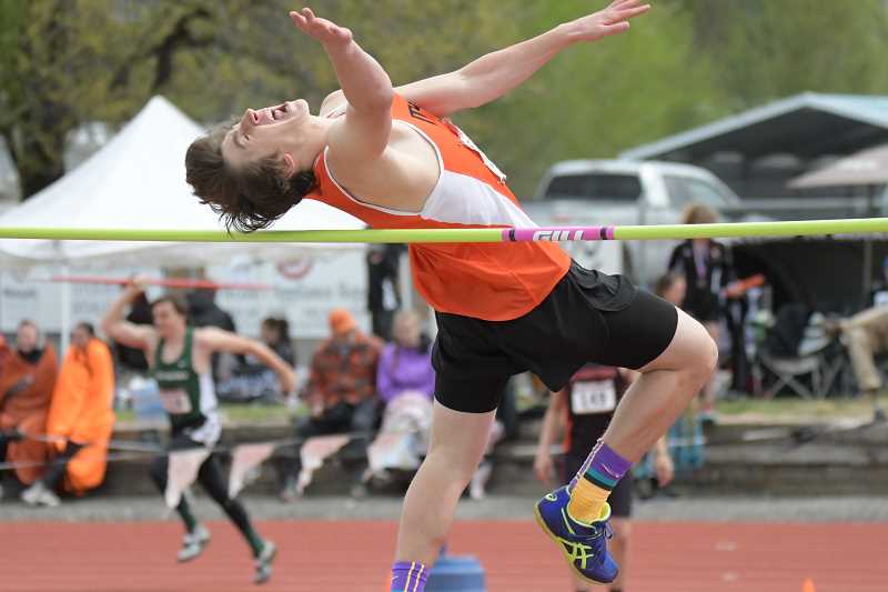 PAMPLIN MEDIA GROUP PHOTO: LON AUSTIN  - Molalla junior Marcus Simpson took first in the High Jump at the Tri-Valley district meet last weekend as he cleared six feet even, tying his personal record. Simpson qualified for the state meet this weekend.