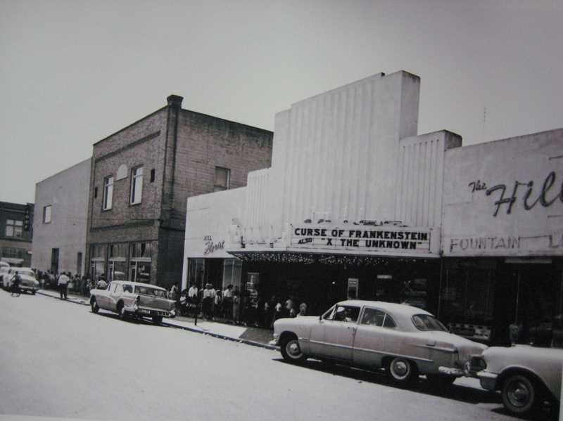 COURTESY PHOTO - Movie goers line up for tickets to 'Curse of Frenkenstein' during the film days at the Hill Theatre in the late 1950s.