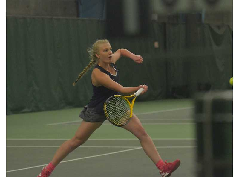 HERALD PHOTO: COREY BUCHANAN - Canby girls tennis player Diana Krishchenko hits a shot at the net during her first round victory at the district tournament.