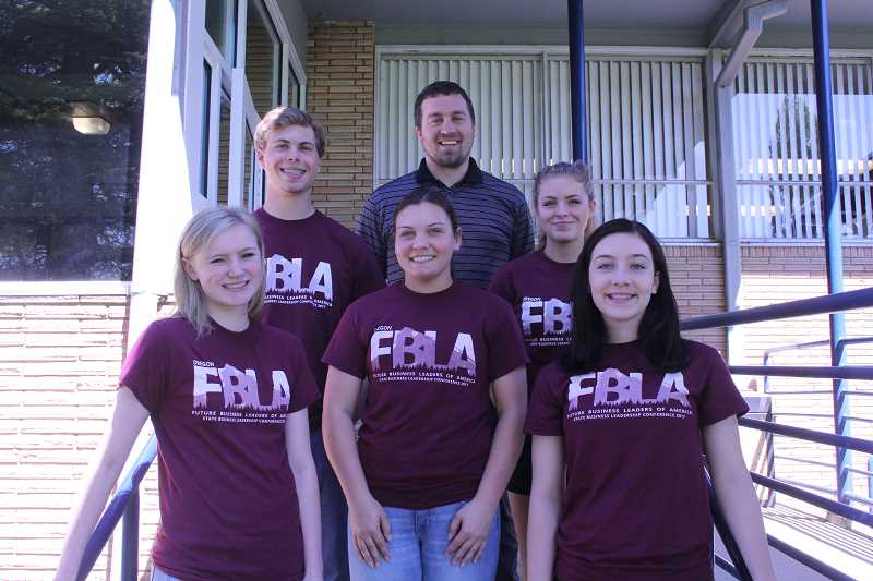 LINDSAY KEEFER - (Clockwise from top center) Adviser Robby Morrissey will lead the Kennedy FBLA team of Lily Flud, Emily Frey, Rebecca Pranger, Molly Jaeger and David Wright to the FBLA National Convention June 26-July 3.