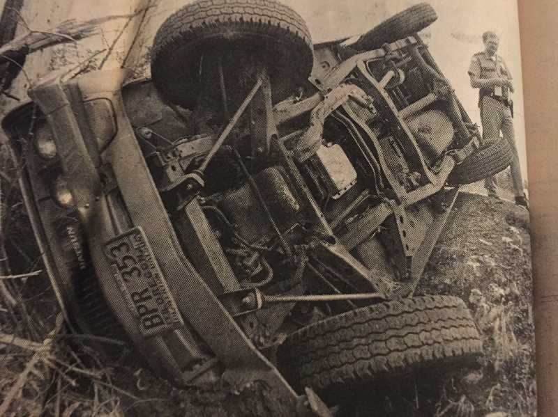 FILE PHOTO - In 1987, a truck overturned on Highway 224 after driver Harold Markham lost control when bugs flew into his eyes. Markham was uninjured.