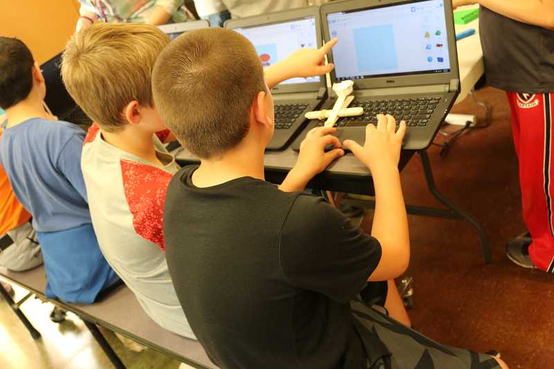 SUBMITTED PHOTOS - Students practice coding skills during Boones Ferry's STEM night Monday, May 8.