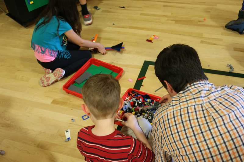 SUBMITTED PHOTO - Boones Ferry Primary students play with Legos during STEM Night Monday, May 8.