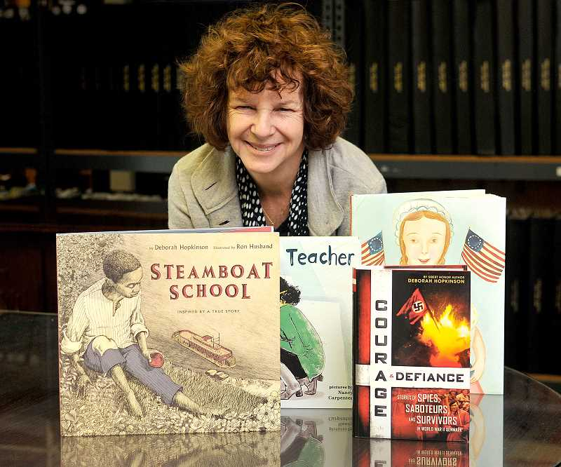 TIDINGS PHOTO: VERN UYETAKE - Local author Deborah Hopkinson was inspired to write a picture book when she read one to her young daughter about 25 years ago, and since then she has written more than 50 books for kids and young adults while also racking up a number of awards.