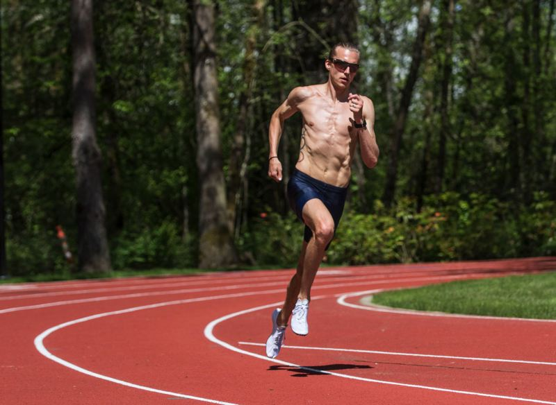 TRIBUNE PHOTO: JONATHAN HOUSE - Evan Jager of Portland, one of the top steeplechasers in the world, trains on the track at the Nike World Campus.