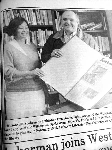 WILSONVILLE SPOKESMAN FILES - Wilsonville Spokesman Publisher Tom Dillon showed up in May 1987 at the public library, to present the first bound volume of the paper -- which first published in 1985 -- to the facility.