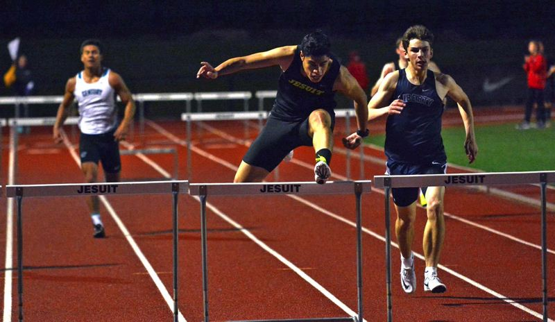 TIMES PHOTO: MATT SINGLEDECKER - Jesuit junior Antonio Angel won the 300 meter hurdles at the Metro League district championship meet.