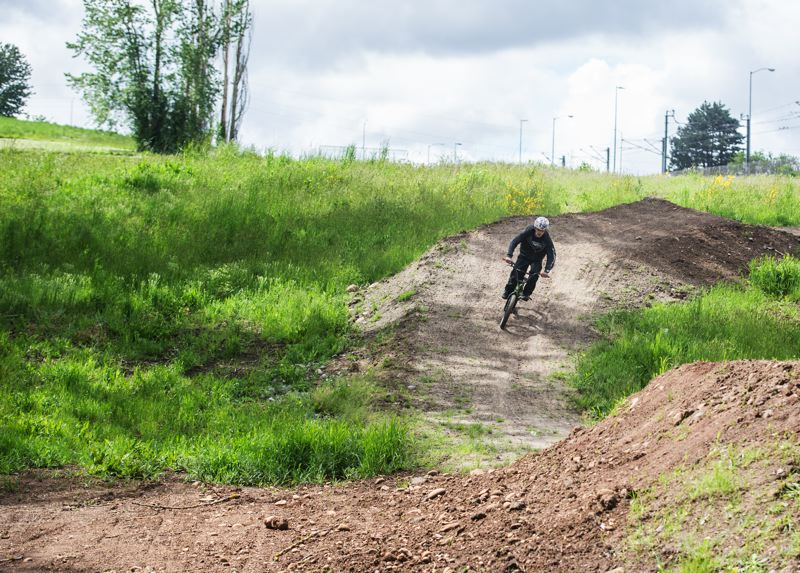 TRIBUNE PHOTO: JONATHAN HOUSE - Anthony Maldonado tests out a trail at Gateway Green. The mountain biking features at the park open June 24.