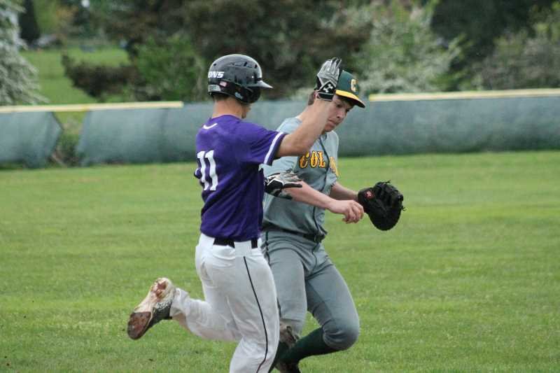 PIONEER PHOTO: CONNER WILLIAMS  - Colton senior Ronny Woodward attempts to beat the runner to first base after fielding a grounder, but the two collide and he's called safe during the Vikings' 10-0 win over Jefferson Tuesday to keep their playoff hopes alive.