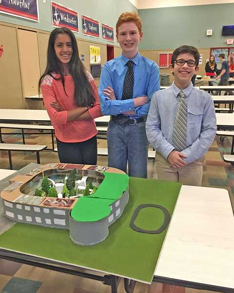 SUBMITTED PHOTO: CATHERINE MELTON - Lakeridge Junior High School students Elina Desphande, Rowan Kirkpatrick and Hamza Said-al-Naief discovered on May 9 that theyd triumphed at the Pacific Northwest Regionals in the SchoolsNext Competition. Here is their doughnut-shaped model of the school of the future.