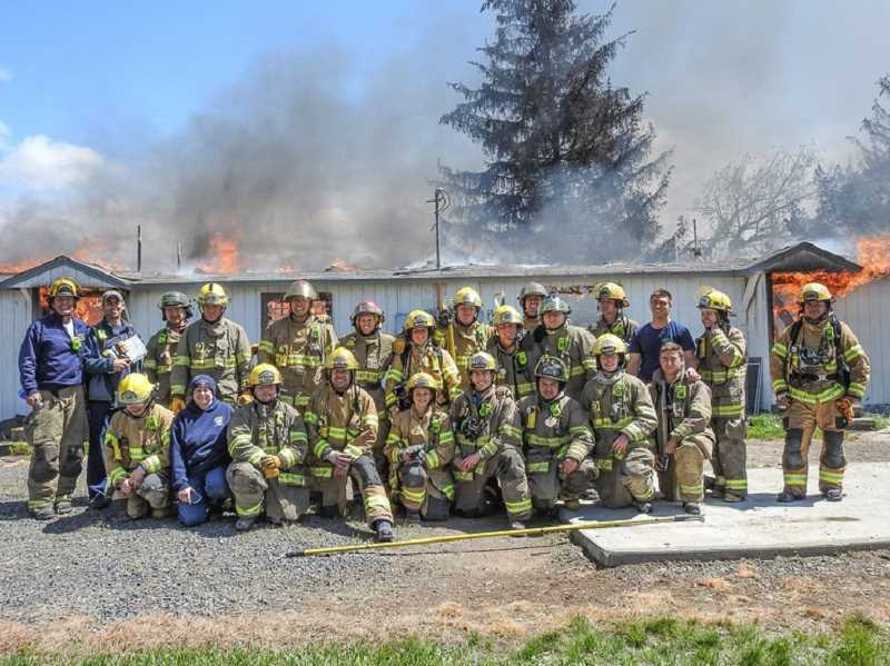 SUBMITTED PHOTO - Twenty-five volunteers, staff members and interns took part in a recent 'Burn to Learn' at the Madras Industrial Site.