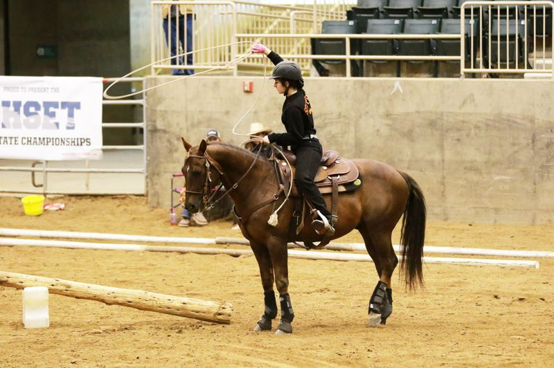 PHOTO COURTESY: DONNA ESPELIEN - Indians senior Kallie Trask rode to eighth in working rancher, tied for 12th in high point individual versatility, came up 14th in reigning, tied for 16th in pole bending, tied for 53rd in high point individual performances, tied for 79th in high point individual timed events and tied for 146th among high point contributors at the Oregon High School Equestrian Teams State Meet Thursday-Sunday, May 10-13, at the Deschutes County Fairgrounds Expo Center in Redmond.
