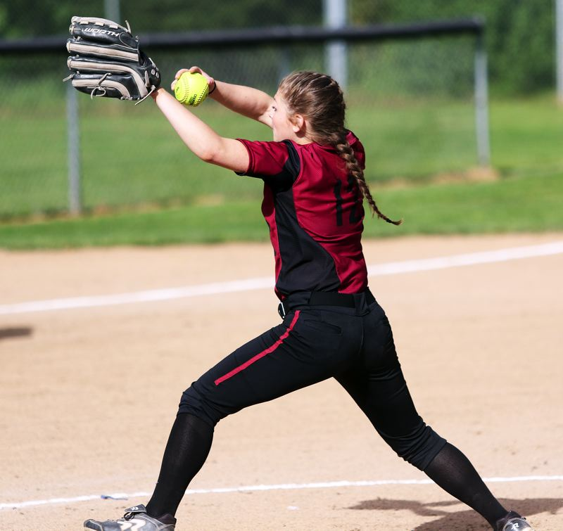 DAN BROOD - Sherwood sophomore Josie Reid gets ready to deliver a pitch during the Lady Bowmen's game with Tualatin.