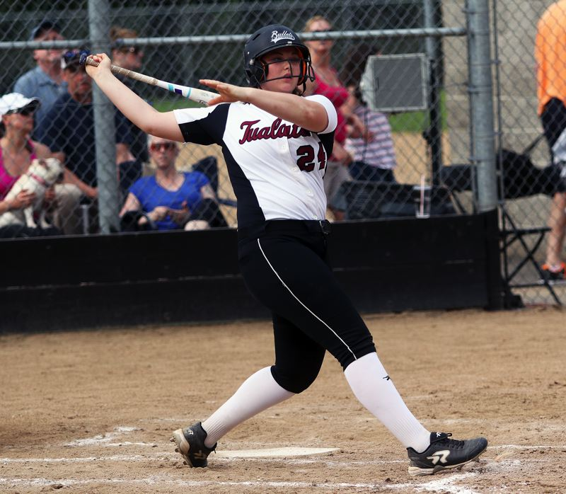 DAN BROOD - Tualatin sophomore Emily Johansen takes a swing during the win at Sherwood. Johansen hit a home run in the victory.