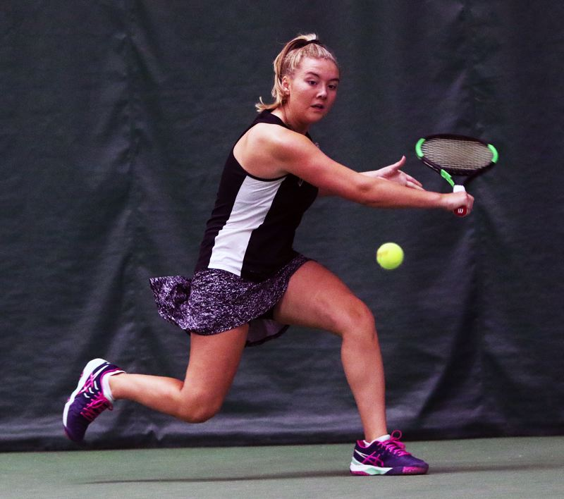 DAN BROOD - Tigard freshman Lizzy Stevens goes to hit a backhand shot during play in the TRL district title match.