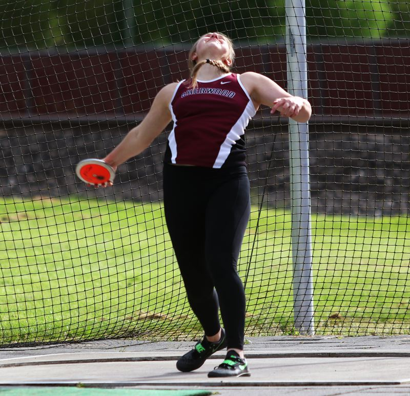 DAN  BROOD - Sherwood High School junior Shelby Moran is about to let the discus fly during action at the Three Rivers League district track and field meet. Moran triumphed in both the discus and shot put events.