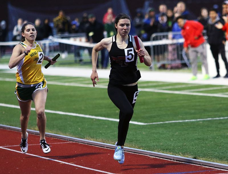 DAN BROOD - Tualatin junior Makenna Bailey (5) sprints to the finish in the 4 x 400 relay.