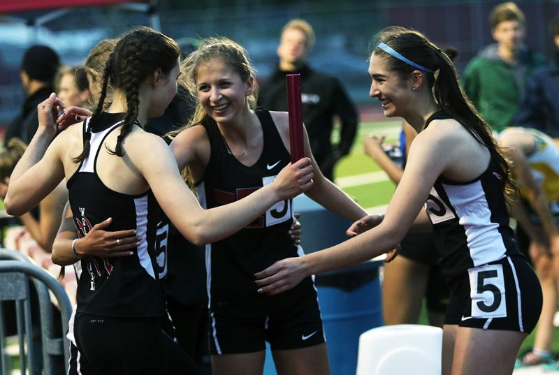 DAN BROOD - The Tualatin girls 4 x 400 relay team, including (from left) Makenna Bailey, Madi Lowry and Kennedy Oleson celebrate after a second-place finish at the district meet.
