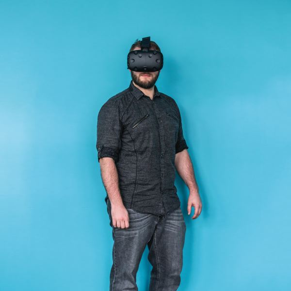 PAMPLIN MEDIA GROUP: JONATHAN HOUSE  - Michael Hill is making bank as a designer-developer of virtual reality environments for local creative agencies. Here he wears the HTC Vive goggles but can design for Oculus Rift too.