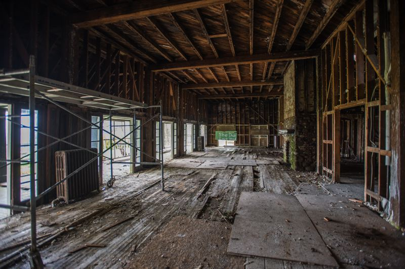 OUTLOOK PHOTO: JOSH KULLA - The interior of the View Point Inn, including the great hall, shown here, are being stripped down to bare wood as part of the restoration process. Gaping holes remain in many of the floorboards, underscoring the complexity of the project.