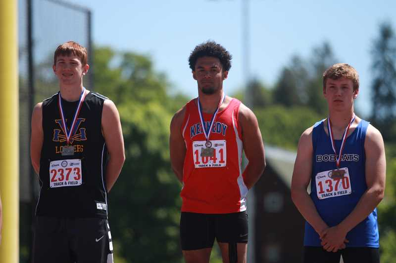 PHIL HAWKINS - Kennedy's Bishop Mitchell matched the 2A state meet record of 22-05.50 in the long jump to win his first state title of his career.