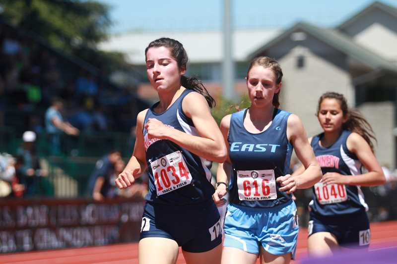 PHIL HAWKINS - Kennedy's Kaylin Cantu (left) led the pack for second place for most of Thursday's 3,000, but was passed East Linn Christian's Sydney Nichol (middle) on the final lap, finishing third with a PR-time of 10:39.94.