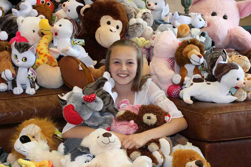 HOLLY SCHOLZ - Eleven-year-old Abbie Jordan collected 153 brand new stuffed animals for the Candlelighters for Children with Cancer organization. She wants children with cancer to have something to comfort them.