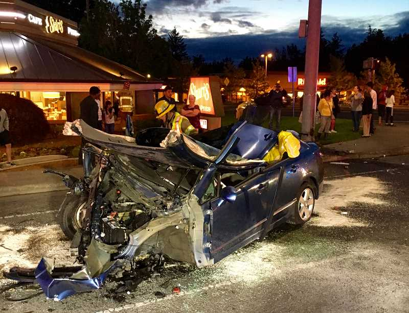 COURTESY OF BEAVERTON POLICE DEPARTMENT - The driver of this car that caught on fire was transported to the hospital on Thursday night.