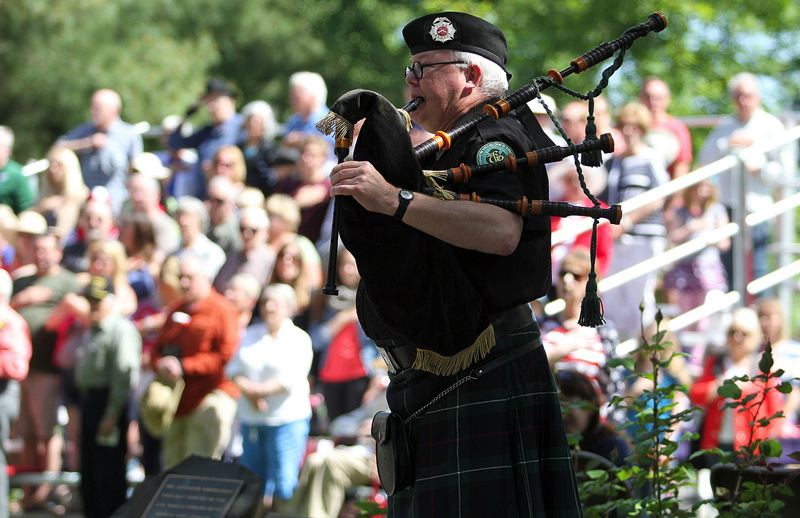 FILE - Tim Birr plays the bagpipes at last year's Memorial Day ceremony at Beaverton Veterans Memorial Park.