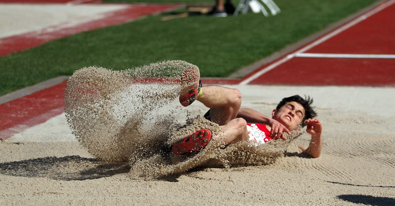 PMG PHOTO: MILES VANCE - Oregon City's Jake Follett may have finished just fifth in Friday's long jump competition, but his efforts helped the Pioneers to their first-ever state championship.
