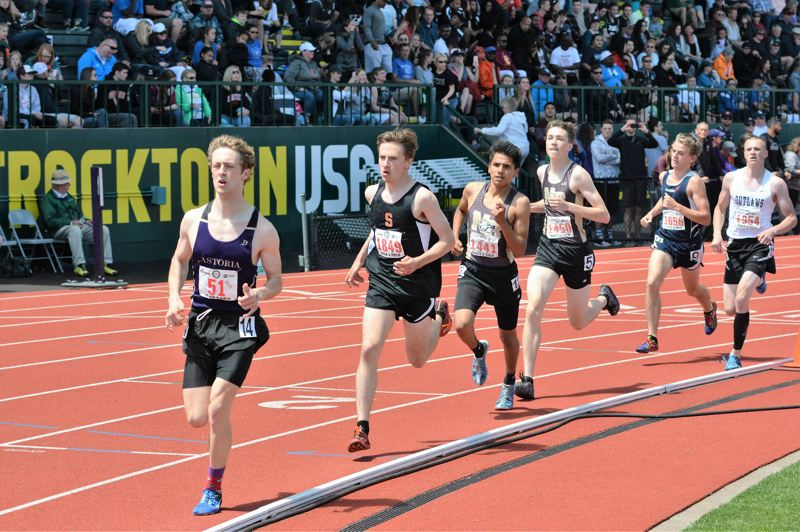SPOTLIGHT PHOTO: JAKE MCNEAL - Indians junior John Kavulich, second from left, raced to second in the boys' 3,000-meter run in 8 minutes, 51.43 seconds to North Bend Michael Brown (8:49.04) and came up fourth in the 1,500 run (4:09.68) to Brown (4:06.87), Astoria senior Lucas Caruana (4:06.92) and North Bend senior George LaGesse (4:08.75).